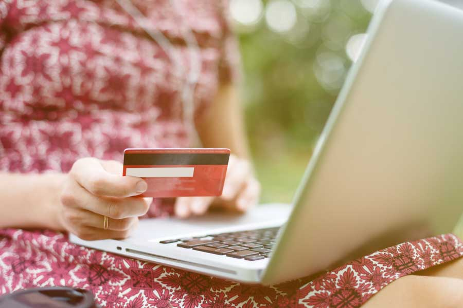 Woman buying something online with credit card